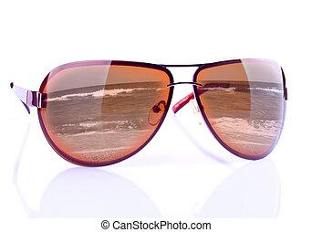 The sunglasses with reflecting seashore