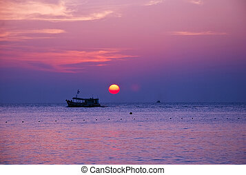 sunrise and boat on sea in the morning