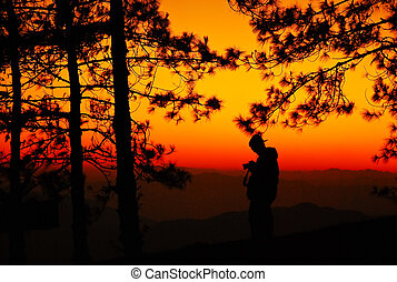 sunrise and mountain pine tree silhouette people man in the morning