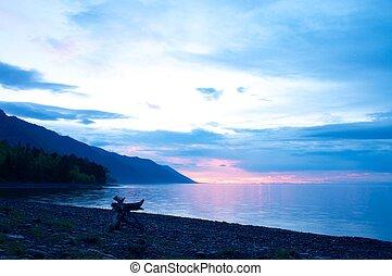 the sunset at Lake Baikal in summer