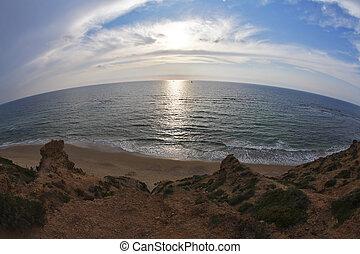 The sunset on coast of Mediterranean sea