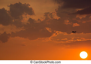 The sunset sky with airplane