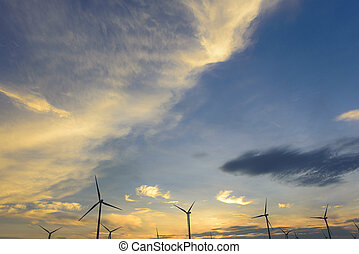 The sunset sky with the wind turbine