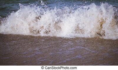 the surf at sea, slow motion - the surf at Azov sea, natural...