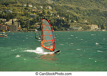 Surfing in the evening on the Garda lake, Torbole, Italy