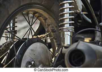 The suspension of the vintage motorcycle.