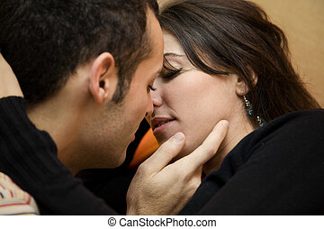 the sweatest thing - portrait of a young couple kissing and ...