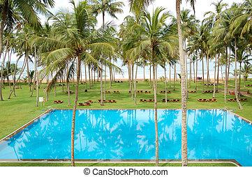 The swimming pool and beach of luxury hotel, Bentota, Sri...