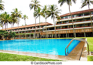 The swimming pool and building of luxury hotel, Bentota, Sri...