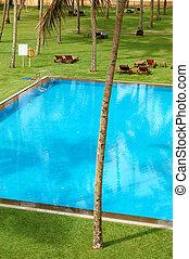 The swimming pool and green lawn at luxury hotel, Bentota, Sri Lanka