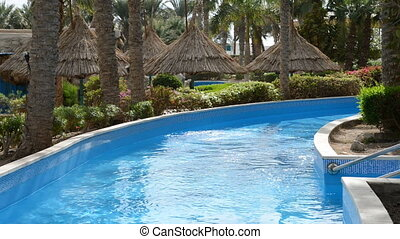 The swimming pool with jacuzzi