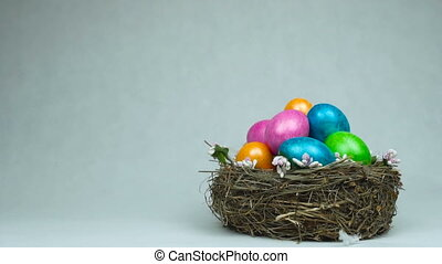 The symbol of Easter dyed and painted colored eggs are in...