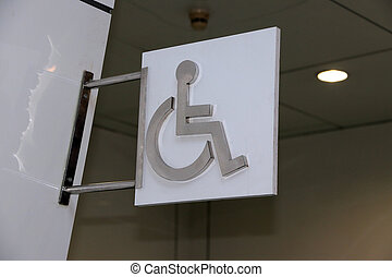 The symbolic sign of Wheelchair Disabled toilet. The sign made from metallic.