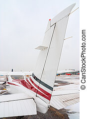 the tail of private plane at the airport is photographed close-up