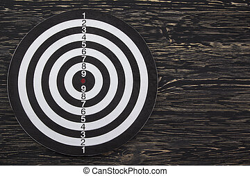 The target isolated on wooden background
