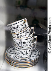 tea cups in the window of a vintage store