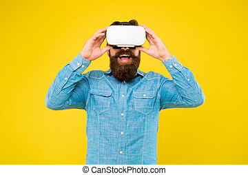 The technology is here. Hipster explore VR technology yellow background. Bearded man wear VR glasses. VR technology and future. Taking advantage of new technology