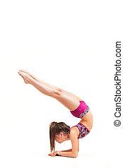The teenager girl doing gymnastics exercises isolated on...