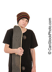 The teenager with a skateboard and in a hat isolated on ...