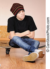 The teenager with a skateboard