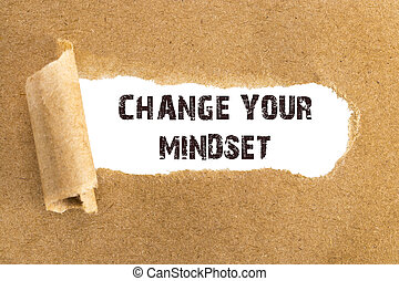 The text CHANGE YOUR MINDSET  appearing behind torn brown paper