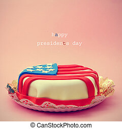 text Happy Presidents Day and a cake ornamented with the flag of