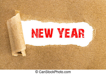The text New Year appearing behind torn brown paper