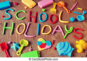 text school holidays made from modelling clay - the text...