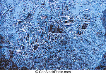 The texture of the frozen blue ice, closeup