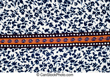 The texture of the silk fabric is white with small blue flowers
