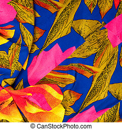 The texture of the silk fabric, red and yellow flowers on a blue background