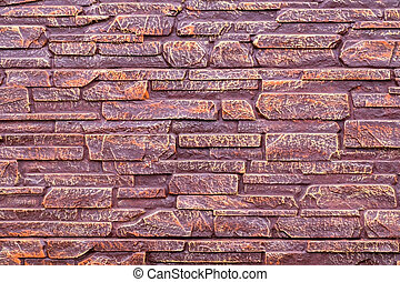 The texture of the stones covered with brown lacquer, can be used as a background