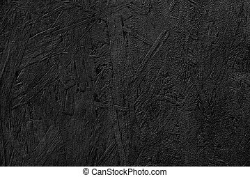 The texture of the wood particle board painted black.