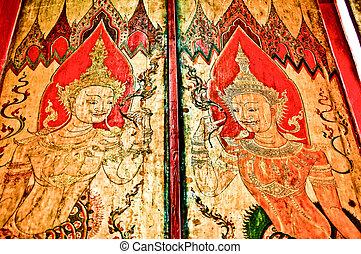 The Thai style art on wooden door of temple