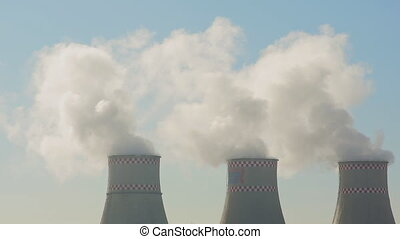 The thick pipe thermal power plant emits smoke