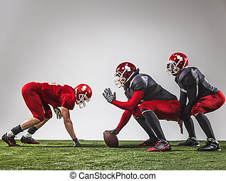 The three american football players in action