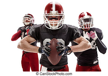 The three american football players posing with ball on...