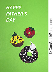The three donuts cut out of colored paper lie on a bright green background