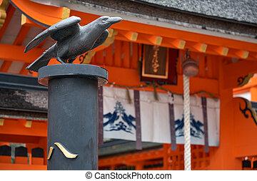 SHINGU, JAPAN ? OCTOBER 27, 2007: Statue of three-legged crow Yatagarasu that guided Emperor Jimmu from Kumano to the plain of Yamato. in front of Kumano Hayatama Taisha shrine. Wakayama