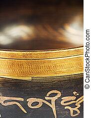 The Tibetan bowl close up - The Tibetan singing bowl on dark...