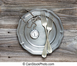 The time - Two vintage fork on a pewter plate