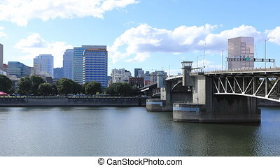 Timelapse Portland, Oregon city center by bridge over...