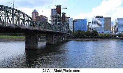 Timelapse Portland, Oregon skyline and bridge over...