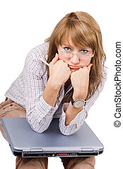 The tired young woman sits with the laptop. Isolated