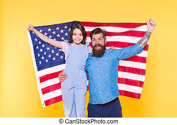 The togetherness of a family. Happy family celebrating independence day. Patriotic family of father and little daughter holding american flag. Family reunion on the 4th of july