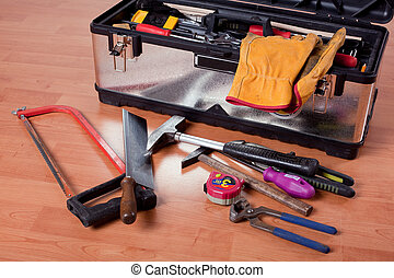 the tools in tool box on wooden floor