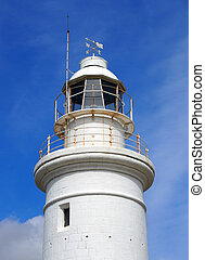 the top of the old white historic lighthouse in paphos cyprus with blue sky