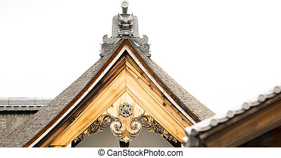 The top wooden roof detail of Japanese temple