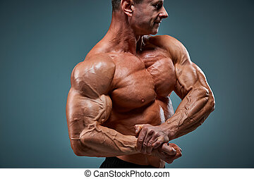 torso of attractive male body builder on gray background. - ...