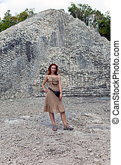 The tourist against pyramid ruins Mexico. Archeologic zone...